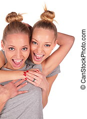 Twin sport girls smiling close-up