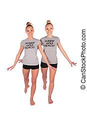 Twin sport girls step forward
