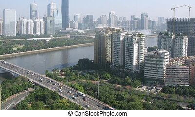 Twin Tower stands up for Guangzhou bridge against blue sky,...