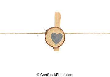 Twine and wooden peg on white background