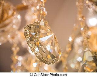 Twinkle, twinkle, crystal chandelier in room