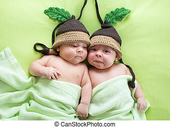 Twins brothers babies weared in acorn hats