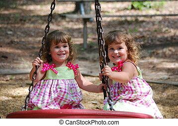Twins on tire swing