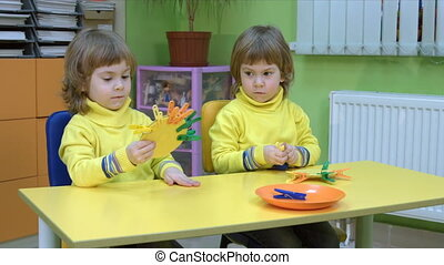 Twins playing an educational game - Four year old children...