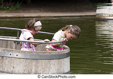 twins playing in a barrel 01 - twins playing on a...