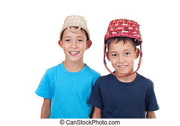 twins playing with wicker baskets