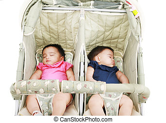 twins sleeping in their stroller