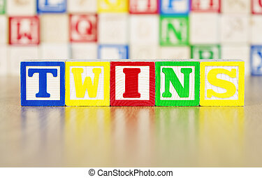 Twins Spelled Out in Alphabet Building Blocks