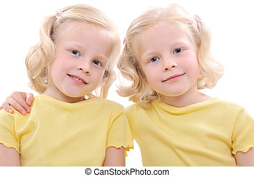 twins - blonde twins girls isolated on white background