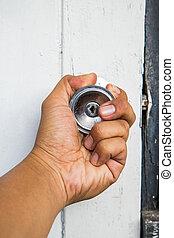Twist knob to open the old door by left hand.