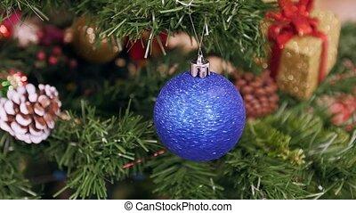 Twisted blue ball on Christmas tree