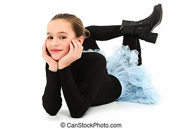 Beautiful 10 year old tween girl laying on floor with legs on backwards over white.