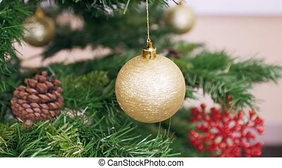 Twisted golden ball on Christmas tree