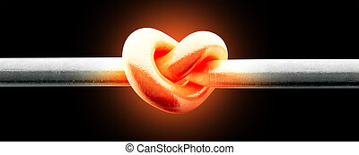 A metal pole twisted into a knotted shape that resembles a heart thats glowing red hot on an isolated background