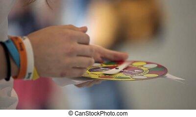 Twister game indoors in woman's hands shot