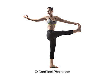 Twisting Extended Hand to Big Toe pose - Sporty beautiful...