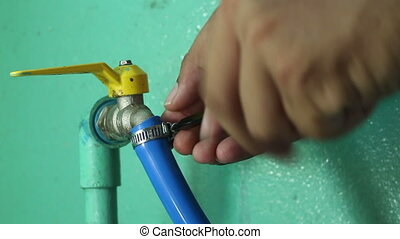 Twists the Hose Clamp To Faucet
