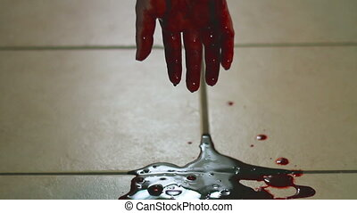 Twitching hand bleeding out horror clip