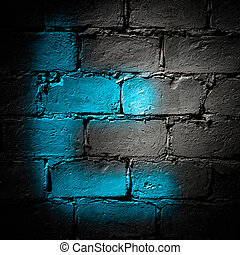 Twitter symbol letter T spryed on a dark wall