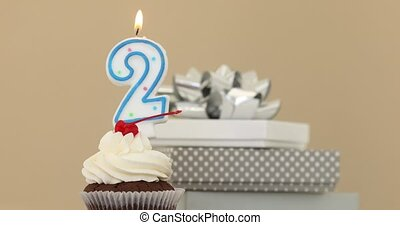 Two 2 candle in cupcake pastel background - Number 2 candle...