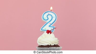 Two 2 candle in cupcake pink background - Number 2 candle in...