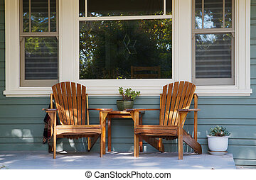Two adirondack chairs porch - Two adirondack chairs on a...