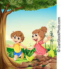 Two adorable kids playing under the tree