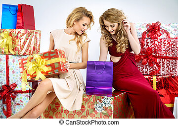 Two adorable women with Christmas gifts