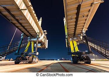 two aerobridge at night