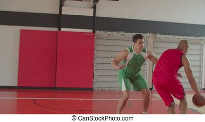 Two african american athletes playing basketball - Two ...