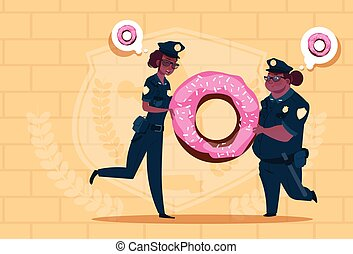 Two African American Police Women Holding Donut Wearing Uniform Female Guards On Blue Bricks Background