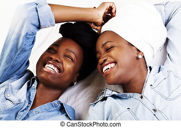 Two African American Women Laughing Portraits Reclining