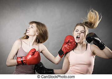 Two agressive women having boxing fight - Two agressive...