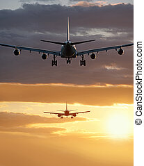 Two aircrafts before landing