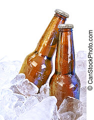 Two Alcohol Brown Glass Beer Bottles on White - Two moist...