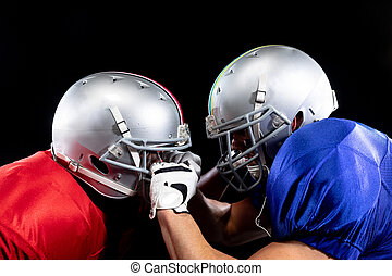 Two American football players in action