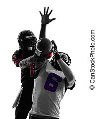 two american football players pass action silhouette - two...