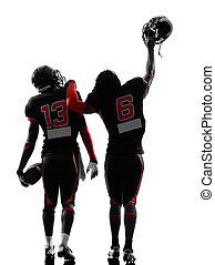 two american football players walking rear view silhouette