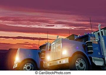 Trucks in Sunset - Two American Large Semi Trucks in Sunset...