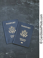 Two American passports on black backgound