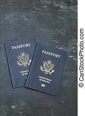 Two American passports on black backgound
