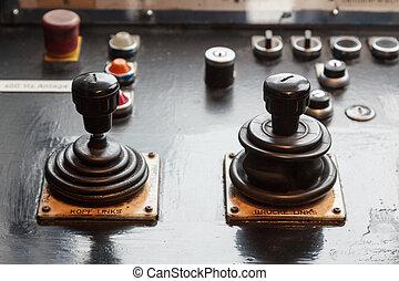 Two analog joysticks on a dashboard
