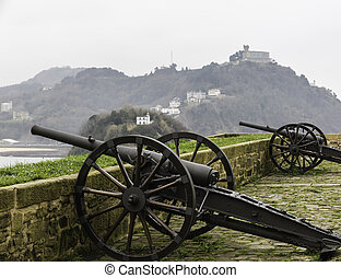 two ancient cannons on a fort wall in Donostia, San Sebastian (Spain)