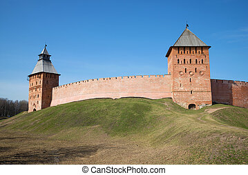 Two ancient towers and wall of the Kremlin of Veliky Novgorod in the sunny April afternoon. Russia
