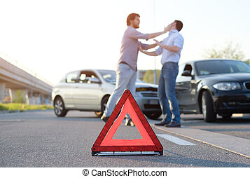 Two angry men arguing after a car crash