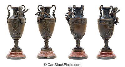 Two antique bronze vases with angel figure.