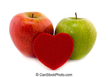 two apples and heart isolated on white