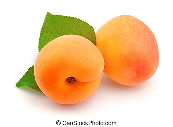 Two apricots with leafs on white background