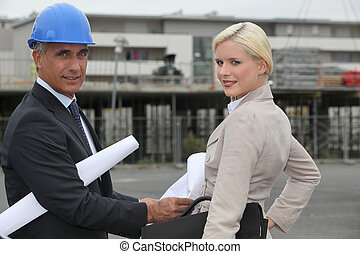 Two architects arriving at site