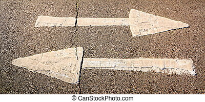 Two arrows on a pavement